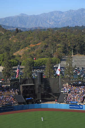 outfield: Los Angeles - June 30, 2012: A sunny day Dodgers baseball game at Dodger Stadium, with scenic moountain view.