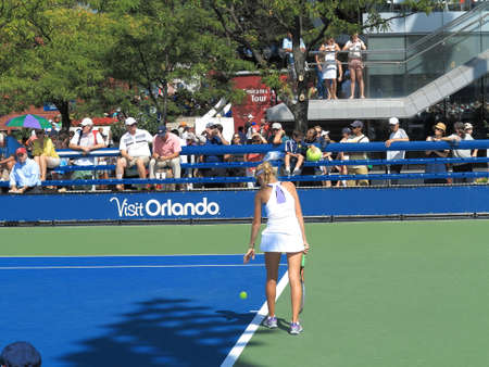 flushing: Flushing, New York - September 3, 2014: Katherine Sebov of Canada serving at a womens singles junior match at the 2014 US Open Tennis Championships. Editorial