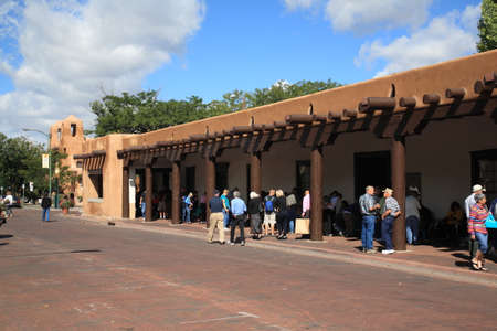 Santa Fe, New Mexico - September 23, 2010: Shoppers and tourists at the Native American market in the Palace of the Governors.
