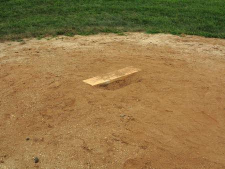 pitchers mound: Baseball Pitching Rubber - Baseball field pitching mound with rubber.