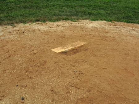 sports league: Baseball Pitching Rubber - Baseball field pitching mound with rubber.