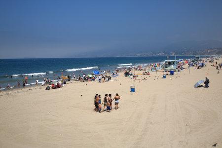 crowded space: Santa Monica, California - July 1, 2012: Santa Monica beachgoers near the famous pier. Editorial