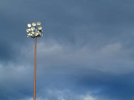 steel tower: Light Tower - Outdoor sports lighting tower and cloudy blue sky.