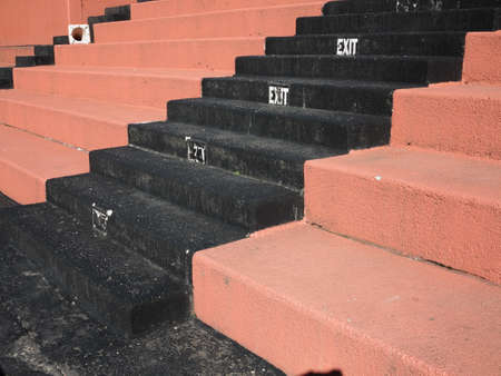 Old Fashioned Sports Seating - Hard concrete bleacher seats in an outdoor sports facility.