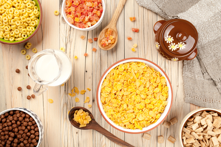 dried fruits: Mix cornflakes milk honey and dried fruits on wooden background