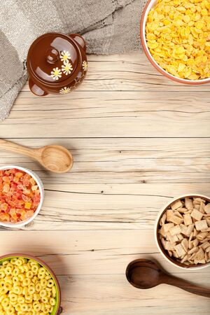 healthy meals: Mix cornflakes honey and dried fruits on wooden background