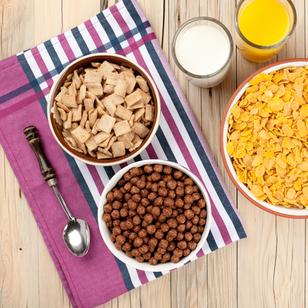 dried fruits: Mix cornflakes nuts milk orange juice honey and dried fruits on wooden background
