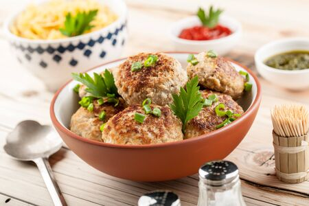 cutlets: Pork chops cutlets in brown bowl on wooden table