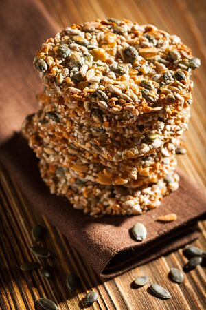 oatmeal cookie: Homemade cookies with seeds on wooden table