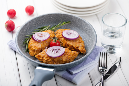 chicken burger: Chicken cutlets baked in corn flakes in a pan Stock Photo