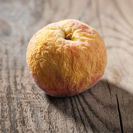 ageing: Old fruit on wooden table Stock Photo