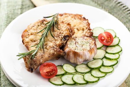 chops: Dish of pork chops with vegetables Stock Photo