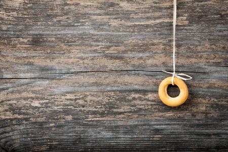 bublik: Bagel on wooden background close-up Stock Photo