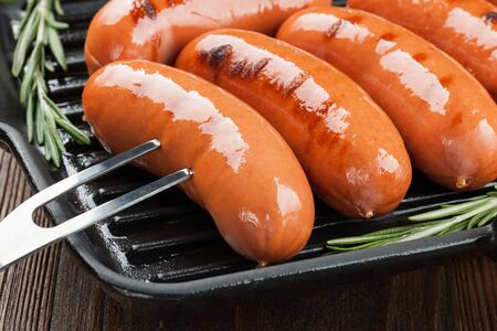 grilled sausages: Grilled sausages on a pan Stock Photo