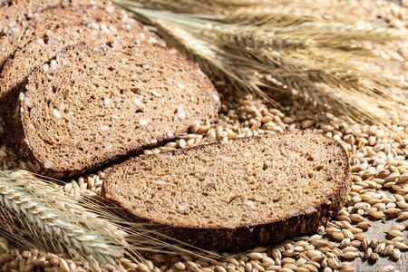rye bread: Sliced rye bread with seeds on a wooden table