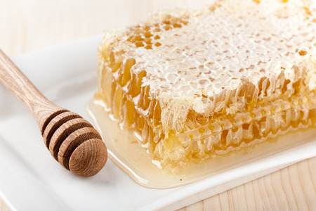 honey comb: Honey comb on wooden table close up