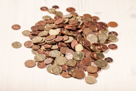 euro coins: Euro coins on the light wooden table