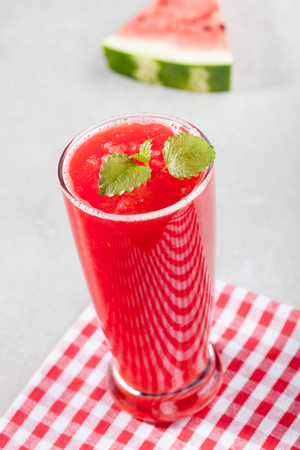 watermelon juice: Glass of watermelon juice with ice and watermelon on the table Stock Photo