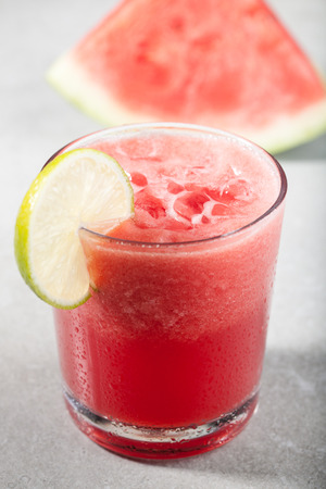 icecube: Glass of watermelon juice with ice and watermelon on the table Stock Photo
