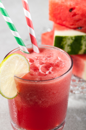 watermelon juice: Glass of watermelon juice with ice and watermelon on the plate