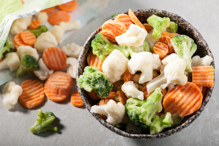 frozen food: Bowl and package of frozen vegetables