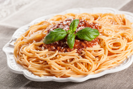 spaghetti sauce: Spaghetti pasta with bolognese sauce and grated parmesan