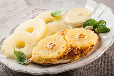 chicken fillet: Meal of grilled chicken fillet with pineapples and pineapple sauce