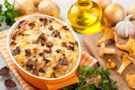 Potato gratin with chanterelles mushrooms and cheese Stock Photo