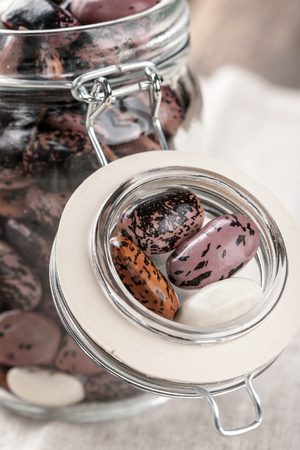 glass jar: Pinto beans and white beans in a glass jar Stock Photo