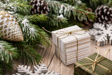 fir branch: Christmas gift boxes on the fir branch background