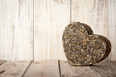 heartshaped: Gift box heart-shaped on wooden boards