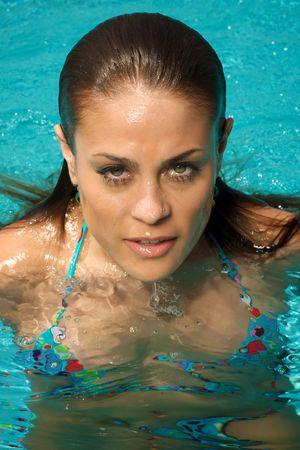 Beautiful woman in a swimming pool. Stock Photo - 3421468
