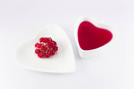 Valentine day concept glass heart shaped with red roses. Stock Photo