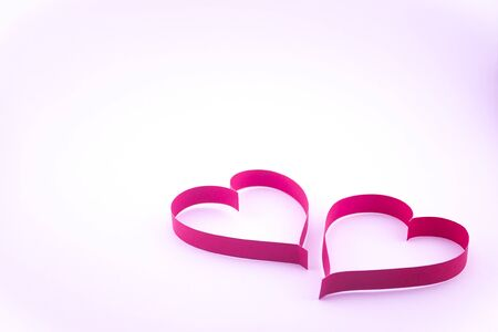 Valentines day., Ribbon red heart on pink background., Concept give a love.