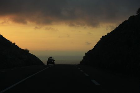 car on the road backlight sunset corsica Stock Photo - 5359724