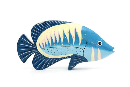 tropical fish made of wood on isolated background photo