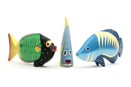 fished: Three colorful wooden fished on isolated background Stock Photo