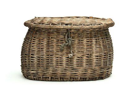 old fisherman basket on isolated background photo