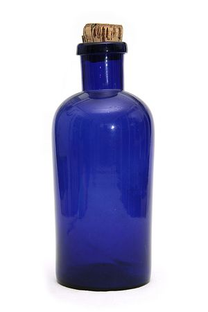 corked: antique pharmacy blue bottle on isolated background
