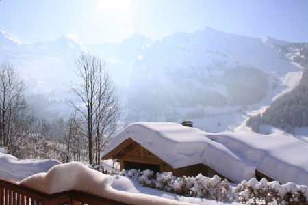 log cabin in snow: chalet roof under the snow in the alps