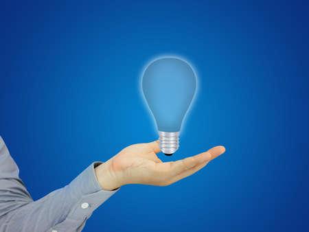 Businessman holding Idea photo