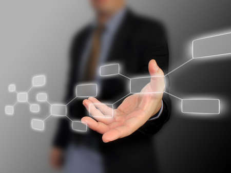 flowchart: Businessman holding diagram  Stock Photo