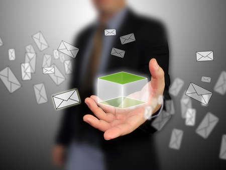 computer user: Businessman holding message box Stock Photo