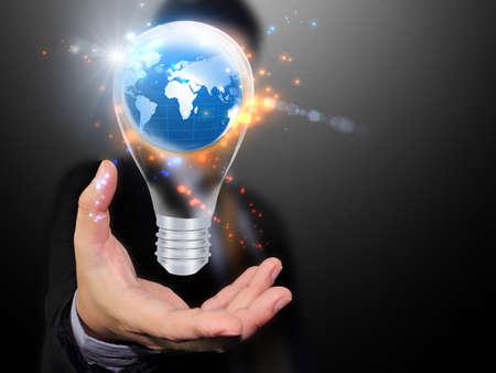 save energy: Light bulb in hand