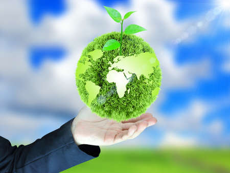 protection of land: green globe in hand Stock Photo