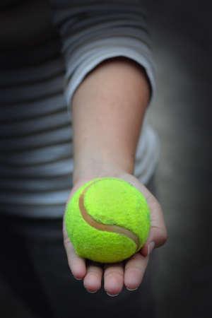 A female holding tennis ball  photo