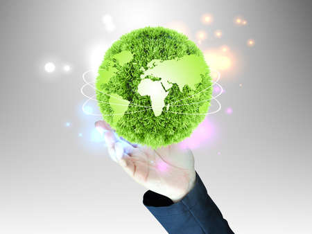 global village: businessman holding glass globe