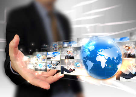 Businessman holding world .Technology concept  photo