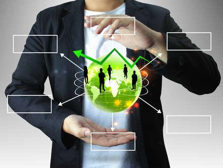 business metaphor: businessman holding business world Stock Photo