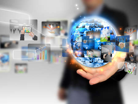 technology business: businessman holding business world  Stock Photo